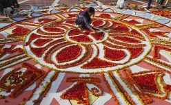 "In this Associated Press photograph by Pavel Rhaman, A Bangladeshi decorates the Shaheed Minar, or martyrs mausoleum, on International Mother Language Day in Dhaka, Bangladesh, Tuesday, Feb. 21, 2012. International Mother Language Day is observed in commemoration of the movement where a number of students died in 1952, defending the recognition of Bangla as a state language of the former East Pakistan, now Bangladesh. Image from the ""Pictures In The News"" site of The Los Angeles Times newspaper."