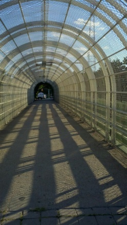 """SS placed the poem, """"Arouse From Your Slumber"""" at the end of this pedestrian overpass ..."""