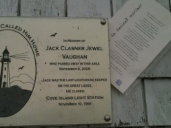 """""""Rhyme of an Ancient Mariner"""" tucked behind a plaque honoring the last lighthouse keeper on the Great Lakes."""